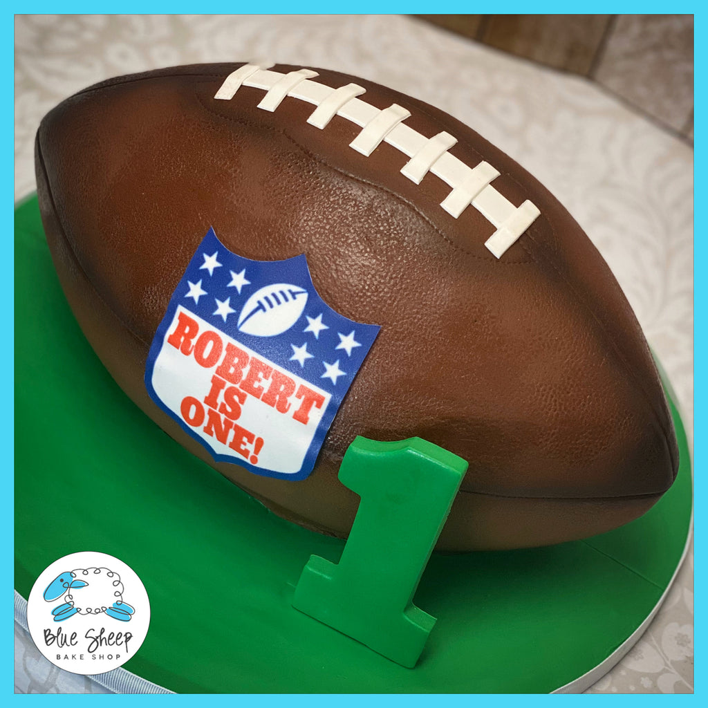 Custom fondant football shaped 1st birthday cake custom cakes nj