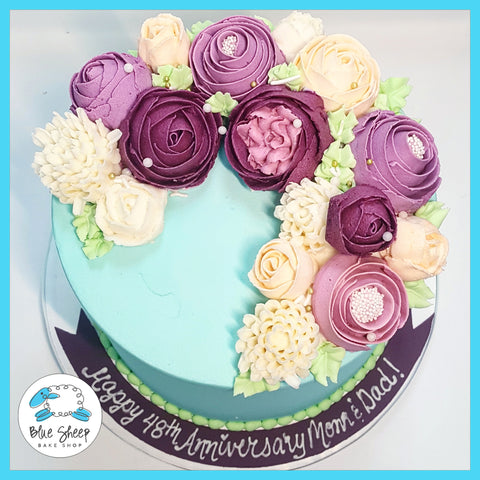 turquoise and purple buttercream floral cake nj