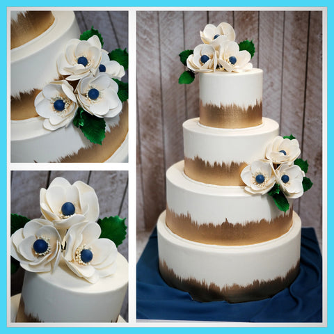 Buttercream wedding cake with sugar anemones.