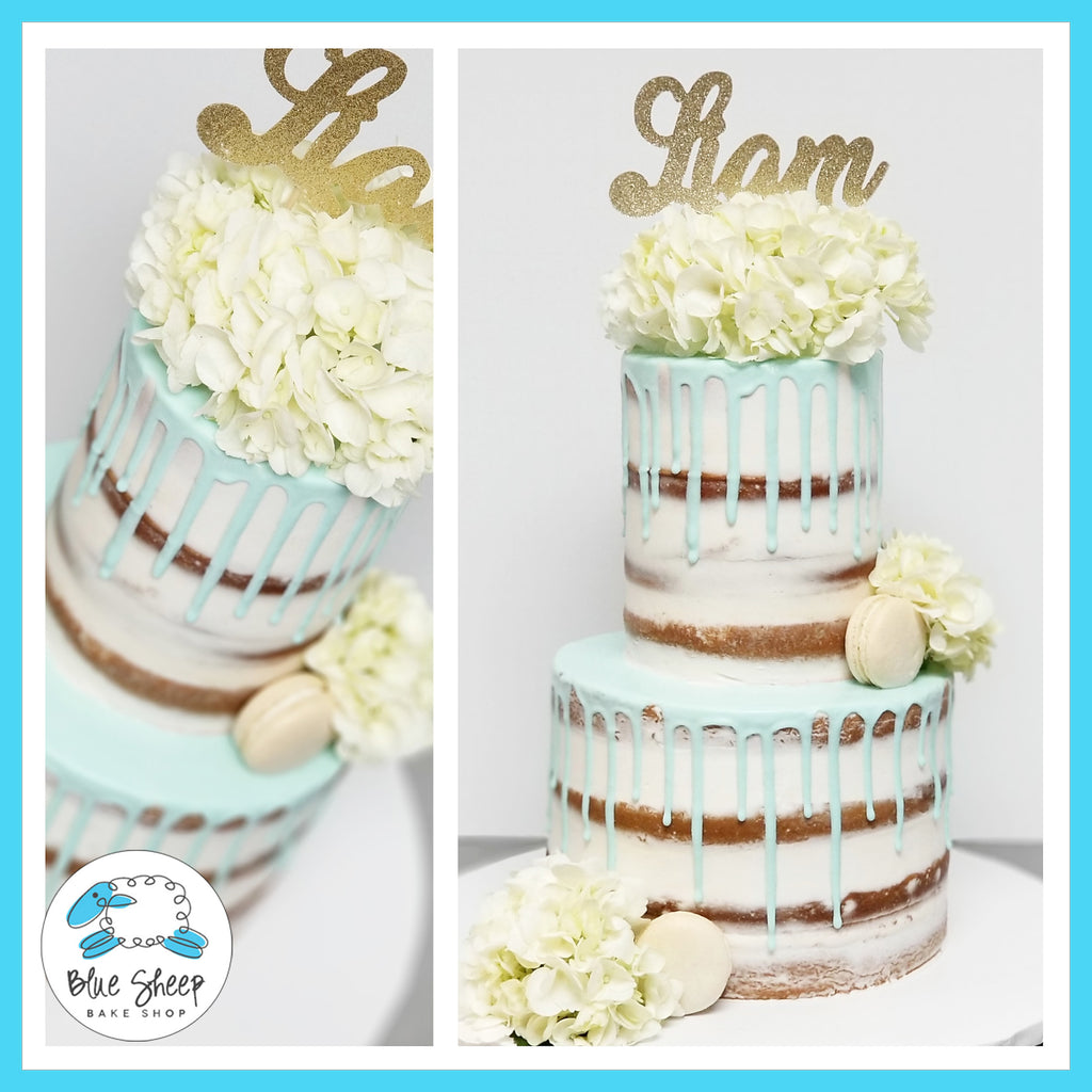 naked christening cake with blue drip fresh florals and macarons NJ