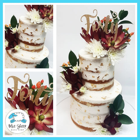 naked wedding cake with gold leaf and fresh fall blooms nj