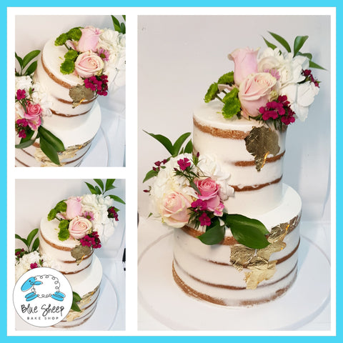 naked wedding cake with gold foil and fresh pink blooms nj