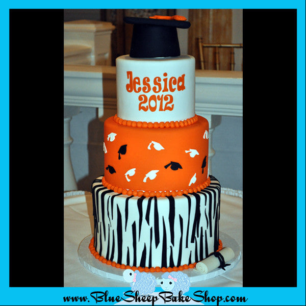 zebra and and orange high school graduation cake