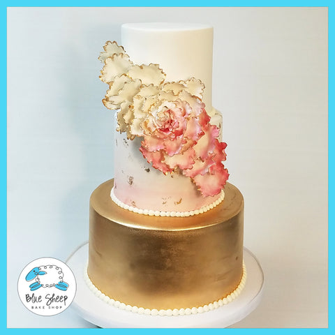 pink and gold wedding cake with peony nj