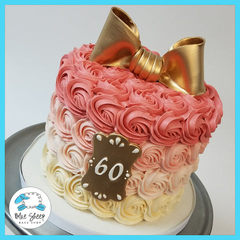pink rosette ombre cake with gold bow nj