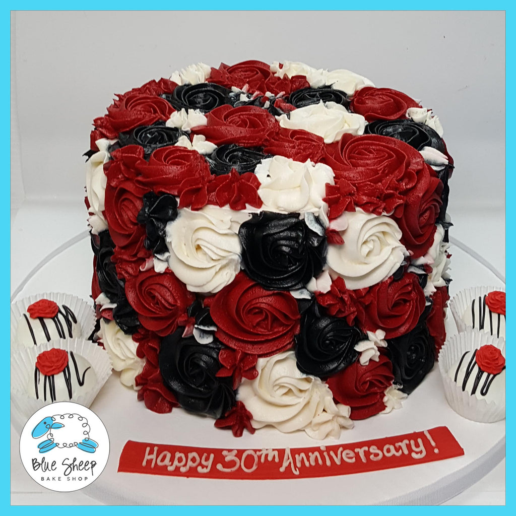 red black white buttercream rosette cake