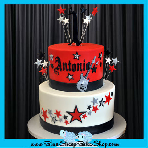 rockstar 1st birthday cake - red, black, white and silver rockstar cake with stars, guitar and gothic lettering