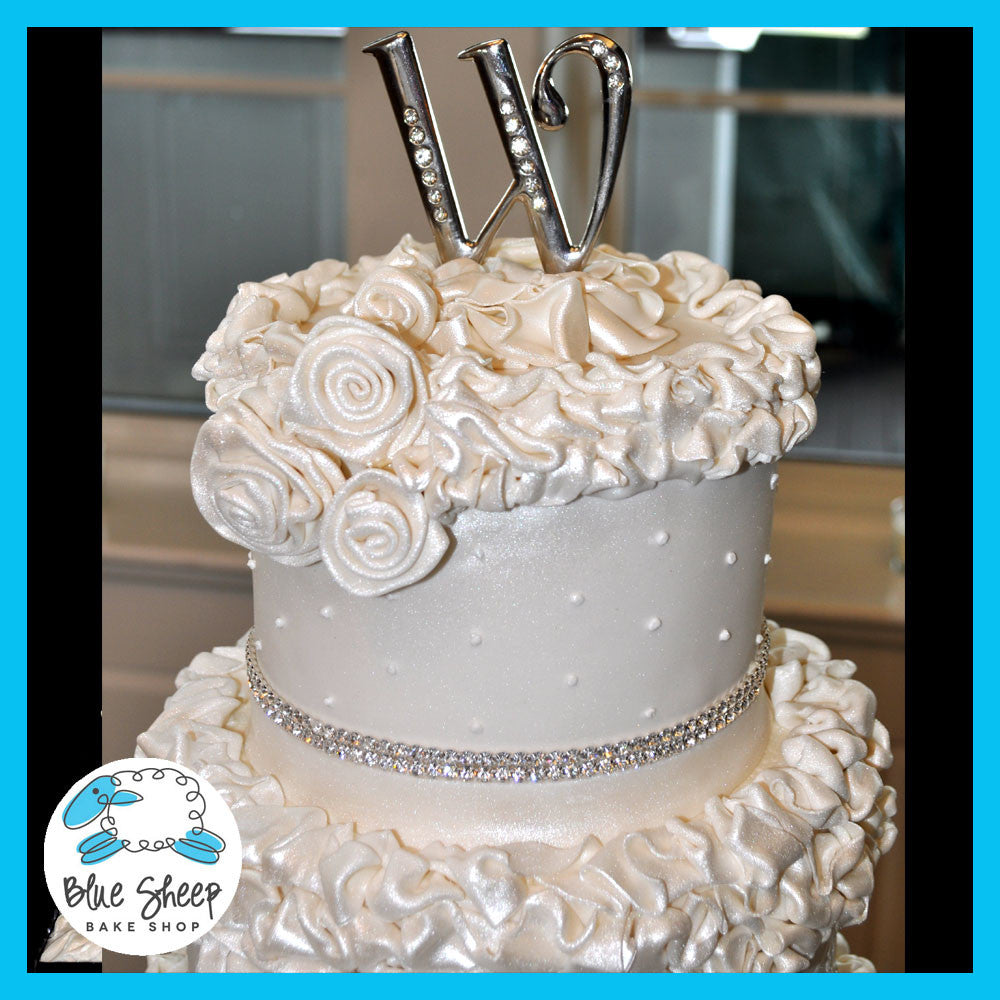 ruffles and roses shimmery wedding cake with crystal banding nj