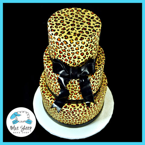 three tiered fondant animal print cake