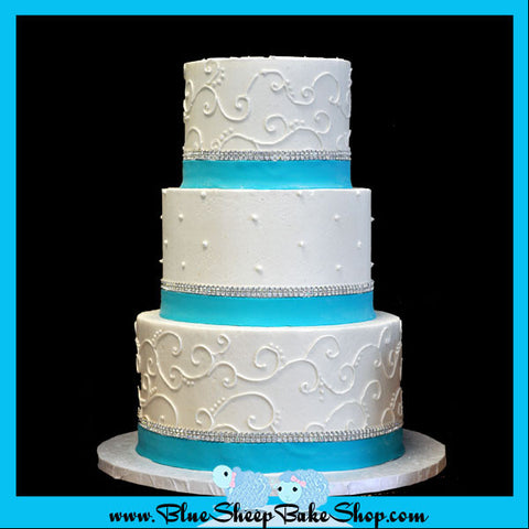 filagree wedding cake with tiffany blue bands and crystal banding