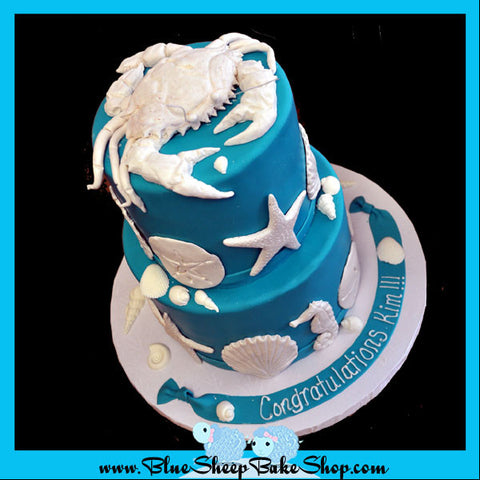 turquoise and white seashell wedding cake