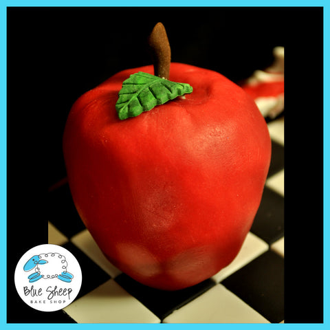 fondant apple from eclipse book on top of chess board cake