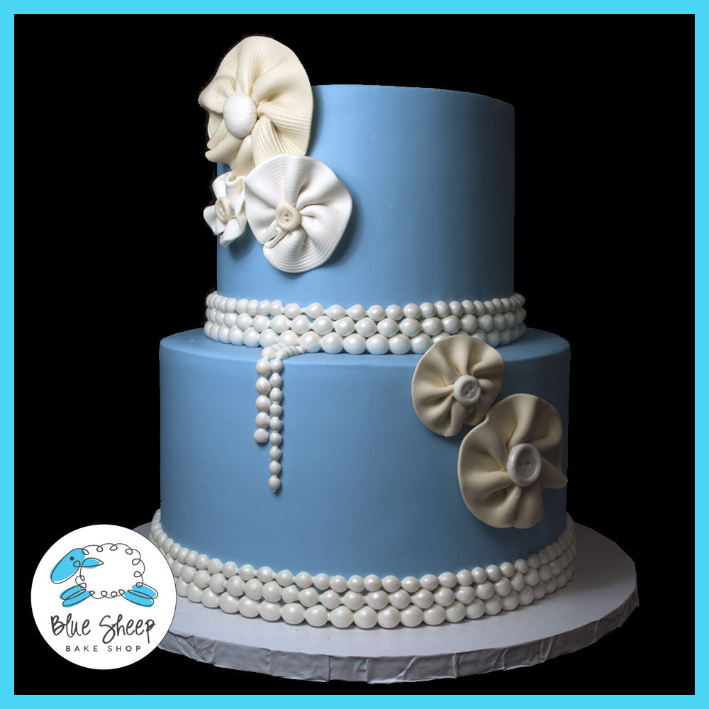 blue vintage pearls and fabric flowers 90th birthday cake