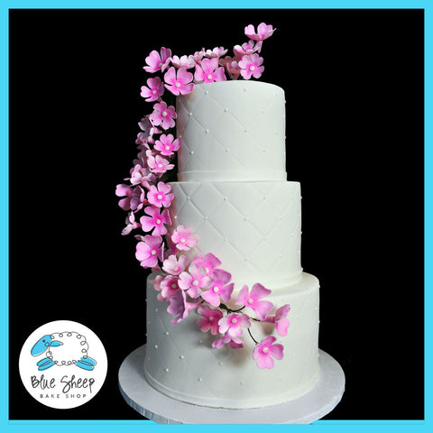 wedding cake with dogwood floral arrangement