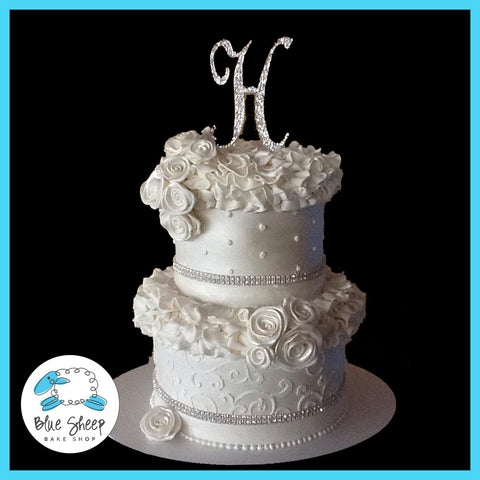 ruffles and roses wedding cake with stenciling and fondant roses and fondant ruffles