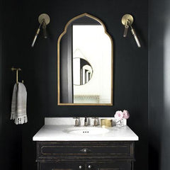 Powder room with ceiling painted the same color as walls for high impact.