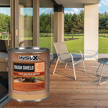 A stained wooden patio  with a beige chair, with an overlay image of a gallon of Insl-X Tough Shield Floor and Patio Coating.