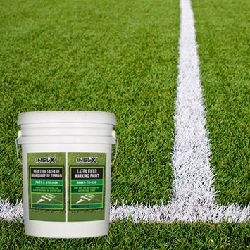 Close up of grass with white painted lines for a soccer field, with an overlay image of a 5 gallon pail of Insl-X Field Marking Paint.