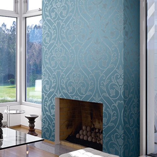 A fireplace with a blue and silver patterned wallpaper from Wallquest's Fiona Collection.