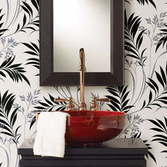 Add wallpaper to your powder room to complete the look.