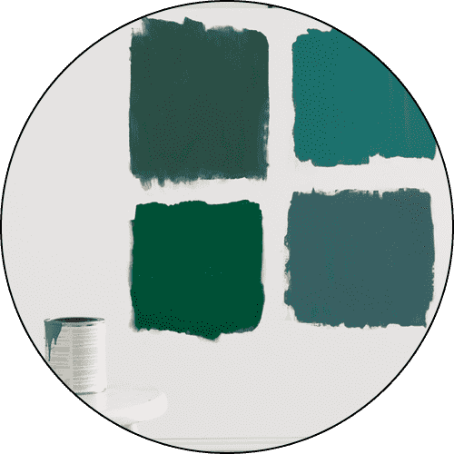 A Benjamin Moore paint color sample pint on a table, in front of a wall showing four different paint colors.
