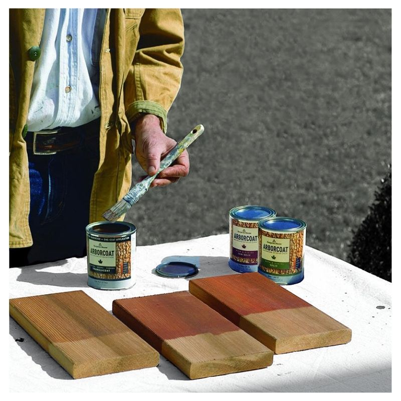 man using benjamin moore exterior stain outside to sample some colors on wood