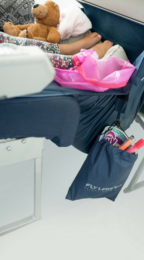 Fly LegsUp for Kids. No more losing toys on flights. Clip on bag for toys and snacks.