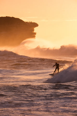 Surfer at dawn in Bronte