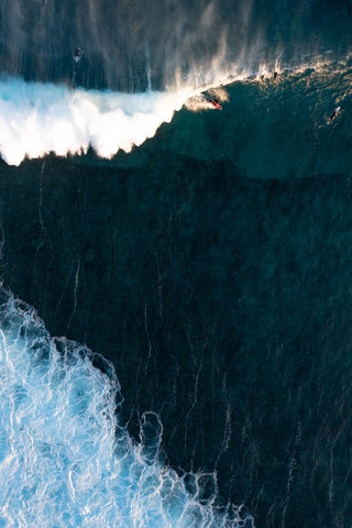 Top down of a surfer in a barrel