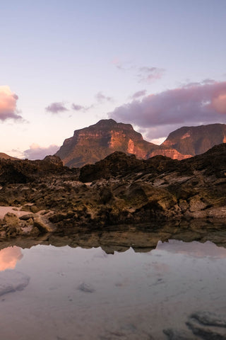 Sunset lights up the face of Mt. Gower in Lord Howe Island