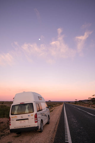 Campervan underneath the early morning moon
