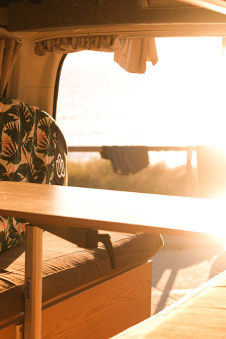 Sunshine streaming into the back of my campervan