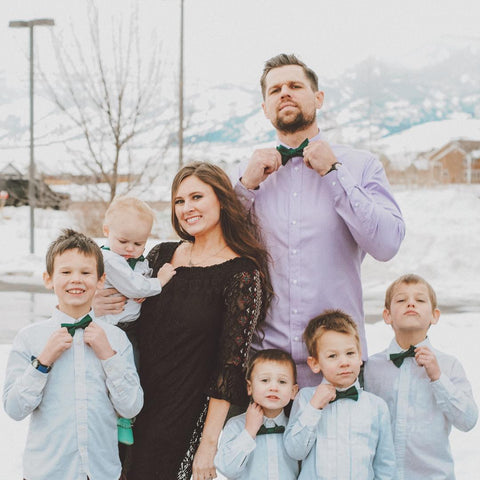 Family wearing green bow ties for their Christmas photo