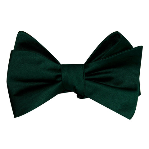 solid dark green bow tie, tied view
