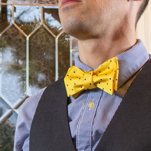 Yellow and navy polka dot bow tie with dress shirt and vest