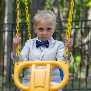 Boy on swing wearing monkey bow tie for kids