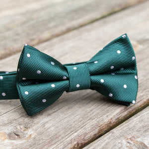 Green with white polka dot boys pre-tied bow tie shown on wood