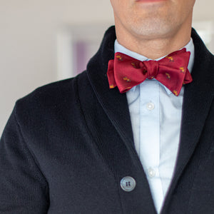 Red reindeer bow tie with navy blue sweater