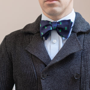 Navy blue Christmas tree bow tie with dark gray knit sweater