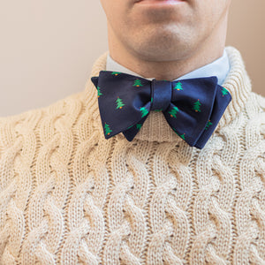 Navy blue Christmas tree bow tie with white knit sweater