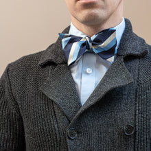 Load image into Gallery viewer, Blue and silver striped bow tie worn with gray knit sweater