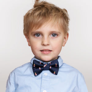 Rocket ship boys bow tie worn with blue button-down shirt