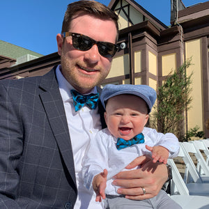 Father and son in matching blue plaid bow ties