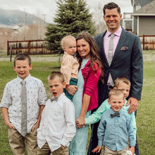Load image into Gallery viewer, Family wearing silver bow ties with pink polka dots