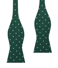 Load image into Gallery viewer, Pine green bow tie with white polka dots for men (untied view)