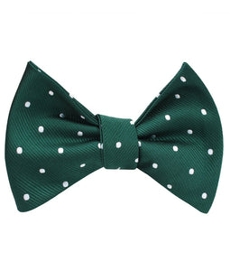 Pine green bow tie with white polka dots for men (tied view)