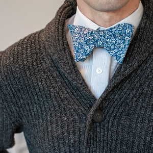 Blue and white floral bow tie with cable knit sweater outfit