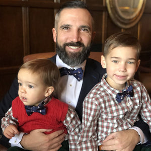 Dad and two boys wearing snowman bow tie