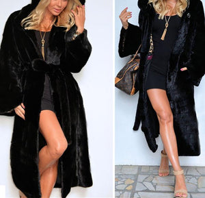 A Black Faux Fur Coat For Warm Coats