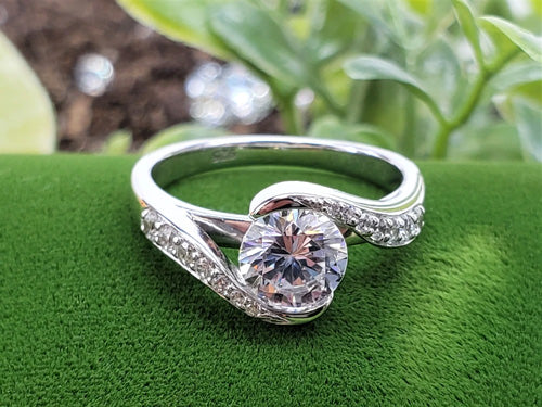 A twisted white gold diamond ring